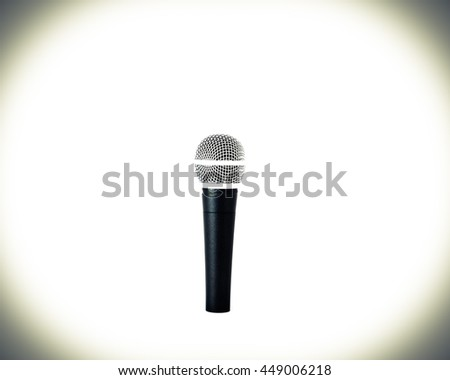 Close-up view of a silver black wireless microphone isolated on white background. Clipping path and copyspace.