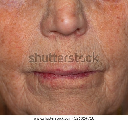 Close-up view of a very old woman??s mouth - stock photo