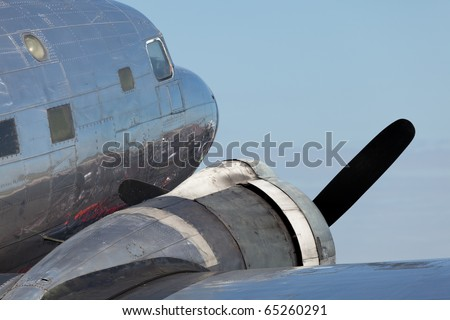 Close up view of a vintage propeller DC-3 airplane.