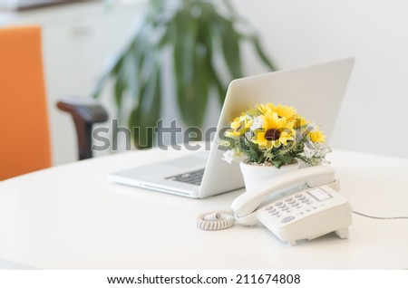 Close up view of a work desk interior with telephone - stock photo