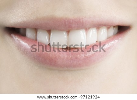 Close up view of a young, fresh, healthy smile. - stock photo