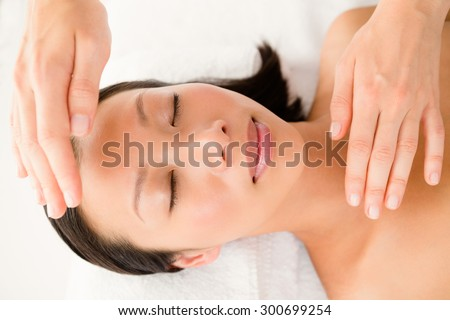 Close up view of a young woman receiving alternative therapy at health spa - stock photo