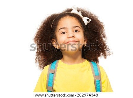 Close-up view of African girl wearing white bow - stock photo