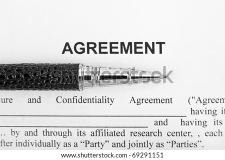 Close-up view of agreement and black pen - stock photo