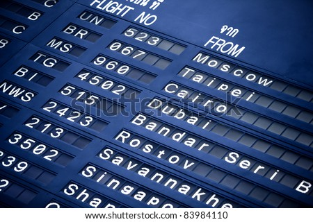 Close up view of airport time-table blue toned - stock photo