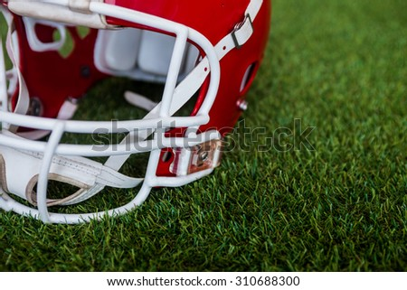 Close up view of an american football helmet on the field - stock photo