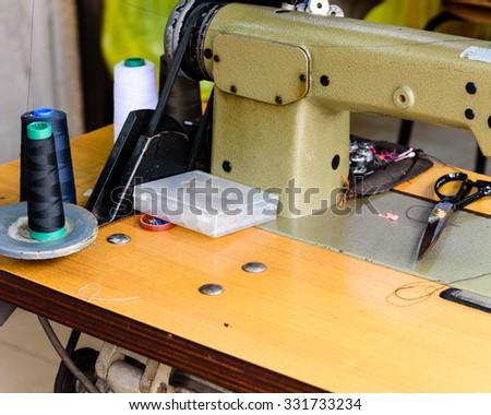 Close-up view of an old sewing machine in action - stock photo