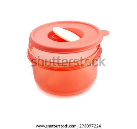 Close up view of an orange plastic container with microwave cover isolated on a white background. - stock photo