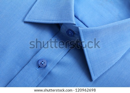 Close up view of blue business shirt. - stock photo
