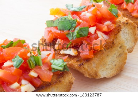 Close up view of bruschetta and ingredients