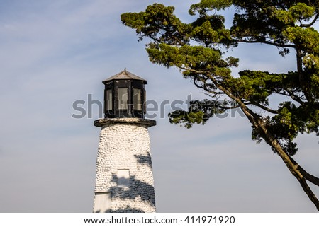 Close-up view of Buckroe Beach lighthouse in Hampton, Virginia on a sunny day. - stock photo