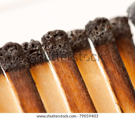 Close-up view of burned wooden matches in matchbook - stock photo