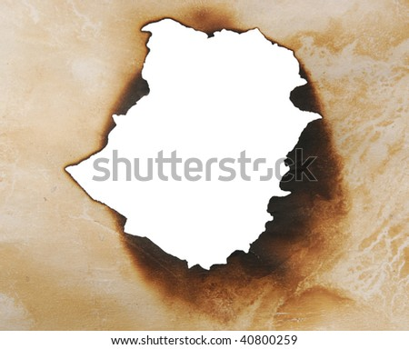 close up view of burnt hole in a paper - stock photo