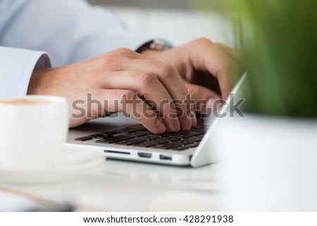 Close up view of businessman, designer or student hands working on laptop. Online distant education, writing blog, freelance, mobile payments, working at office or at home concept. - stock photo