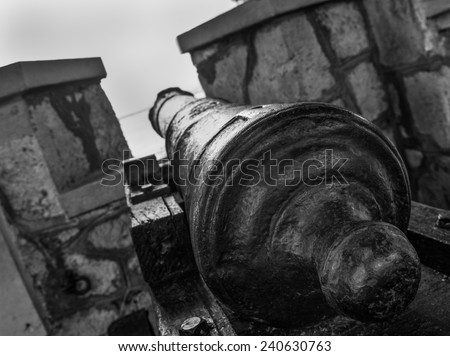 Close up view of cannon in black and white in Jamaica.
