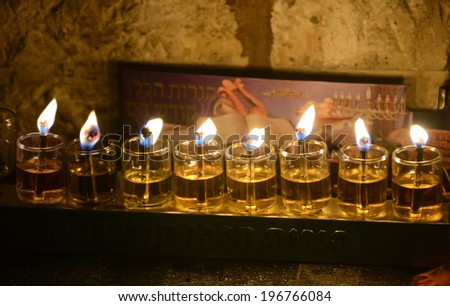 Close up view of Chanukkah candles in Jerusalem Old City.  - stock photo