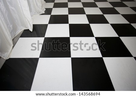 Close-up view of chequered floor - stock photo