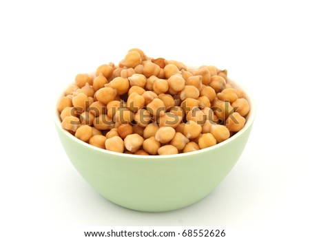 Close up view of chickpea in green bowl on white background - stock photo