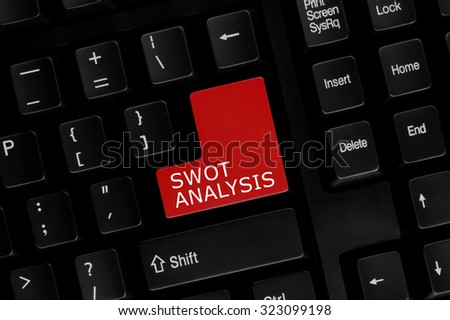 Close-up view of computer keyboard with SWOT Analysis words on keyboard button. - stock photo