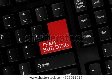 Close-up view of computer keyboard with Team Building words on keyboard button.