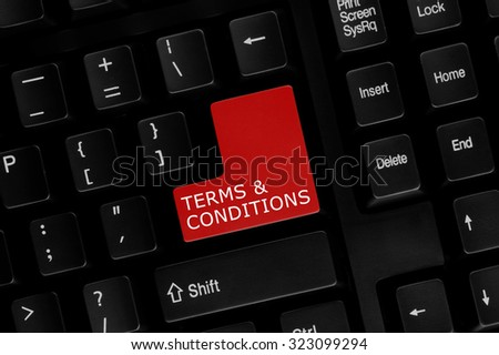 Close-up view of computer keyboard with Terms & Conditions words on keyboard button. - stock photo