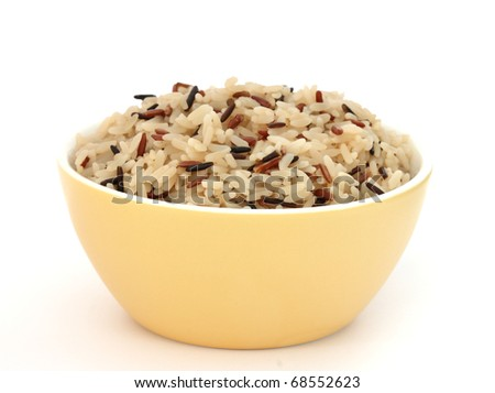 Close up view of cooked variety of rice sorts in yellow bowl - basmati and indian black - stock photo