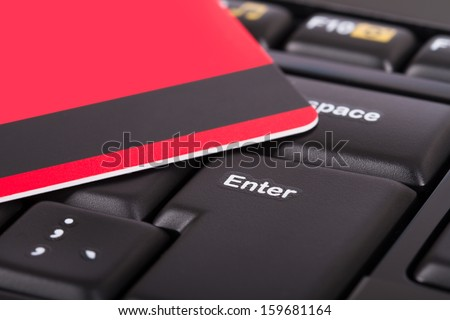 Close up view of credit card on black computer keyboard. - stock photo
