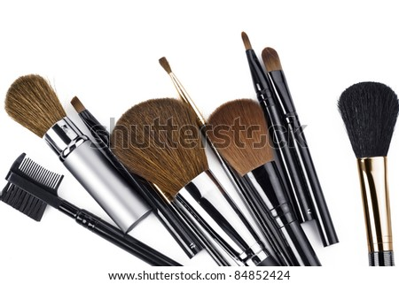 Close up view of different  brushes  on  white back - stock photo