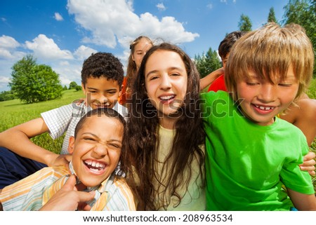 Close up view of excited kids in a group together - stock photo