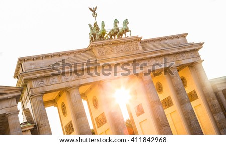 Close-up view of famous Brandenburger Tor (Brandenburg Gate) in beautiful golden evening light at sunset in summer with retro vintage Instagram style pastel toned filter effect, Berlin, Germany - stock photo