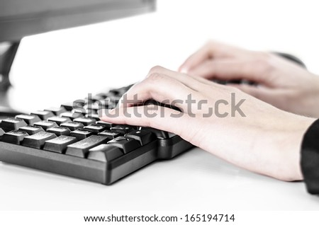 Close up view of female hands touching computer keyboard - stock photo