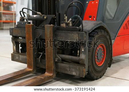Close-up view of forklift loader forks. - stock photo
