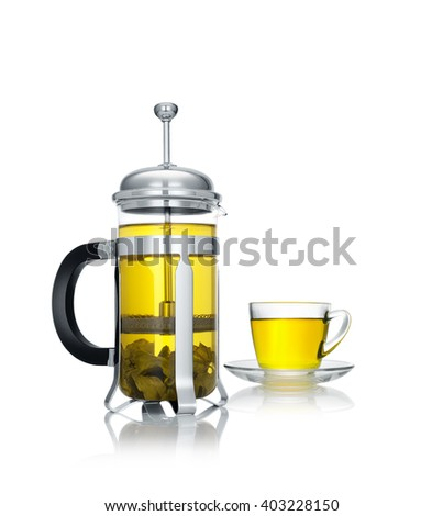 close up view of french press and a cup of green tea on white background - stock photo