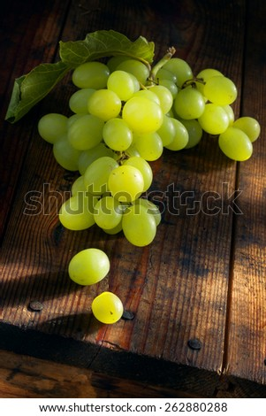 close up view of fresh grape  on color back - stock photo