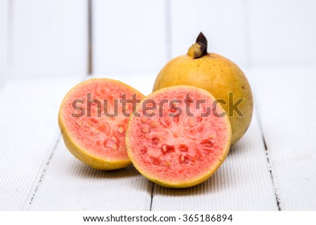 Close up view of fresh guava fruits on a white background.