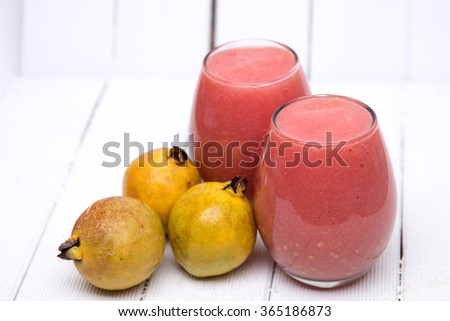 Close up view of fresh guava juice on a white background.