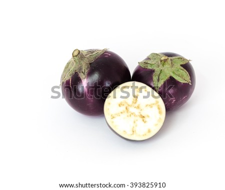 Close-up view of fresh organic raw ripe Eggplants (or Brinjal, aubergine) and half cut segment isolated on white background with copy space. - stock photo