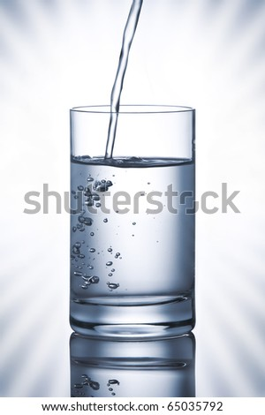 close up view of glass full of water on white background
