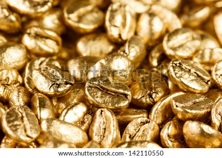 Close up view of gold coffee beans