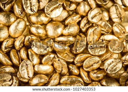 Close up view of gold coffee beans background