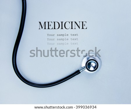 Close up view of grey stethoscope on white background. - stock photo