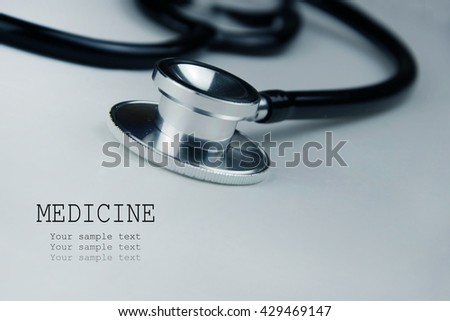 Close up view of grey stethoscope on white background.