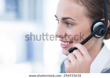 Close up view of happy businesswoman with headset in call center