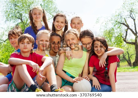 Close-up view of happy teenagers sitting close - stock photo