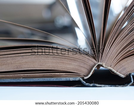 Close up view of in the middle open book, turning pages - stock photo