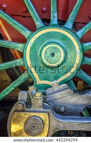 Close up view of locomotive wheel spokes  and metal parts. - stock photo