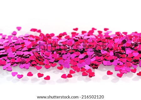 close-up view of many small pink glitter hearts - stock photo