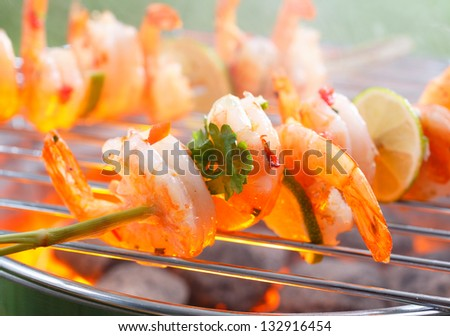 Close up view of Mexican grilled shrimp on stick - stock photo