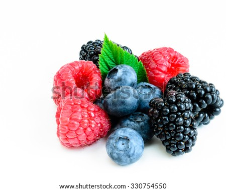 Close-up view of mixed, assorted berries blackberry, strawberry, blueberry, raspberry with green leave isolated on white background. Colorful and healthy concept. Black, blue, red, green - stock photo