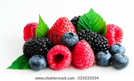 Close-up view of mixed, assorted berries blackberry, strawberry, blueberry, raspberry with green leave isolated on white background. Colorful and healthy concept. Black, blue, red, green color - stock photo